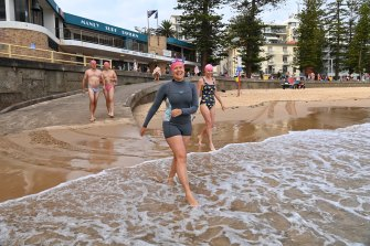 Heidi Wintermeyer, part of Manly's Bold and Beautiful swim group, enters the ocean.