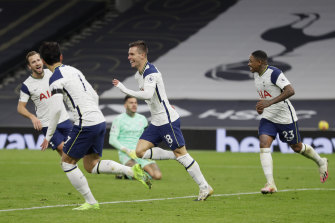 Giovani Lo Celso (second right) celebrates scoring Spurs' second goal.