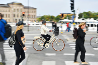 A commuter cycles in Stockholm, Sweden, where COVID-19 cases have begun to rise again.