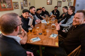 Books can be tough: Shay Leighton, front right, at a Tough Guy Book Club meeting at Goldy's Tavern, Collingwood.