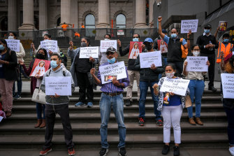 Protesters on the steps of Parliament House on Tuesday.