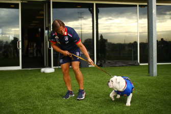 Coach Luke Beveridge with club mascot Caesar. The Western Bulldogs are confident they can weather the financial hit of this disrupted season.