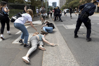 Students and staff were pushed to the ground at the protests on Wednesday.