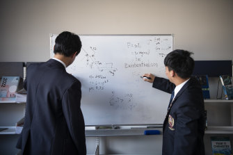 Students practise physics together.