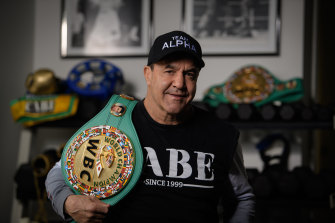 Jeff Fenech at home in Sydney with one of his belts.