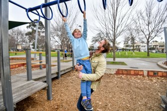 Toby Cummings and his son Louis, 8, enjoy themselves at Curtain Square park on Monday ahead of the announcement of tightened COVID-19 restriction that will, among other things, result in the closure of playgrounds.