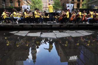 Happier times: The Sydney Youth Orchestra performs in Martin Place in 2018.