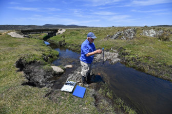 Professor Geoffrey Hope of the Australian National University tests water quality near Yarrangobilly in Kosciuszko National Park before last summer's bushfires.