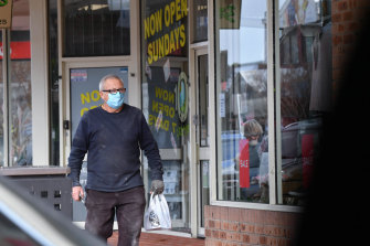 A man in Pakenham wearing a face mask on Friday.