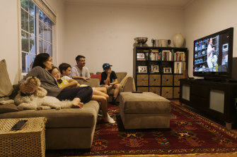 Emma McCormack and family settle in to watch evening TV at home in Hunters Hill.