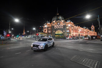 Flinders Street Station just after the curfew came into force at 8pm on Sunday.