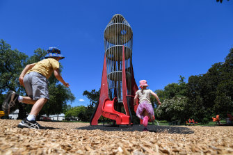 Magnet for kids: Henry and Eloise Gannon shoot towards the rocket play tower in Central Gardens, Hawthorn on Wednesday.