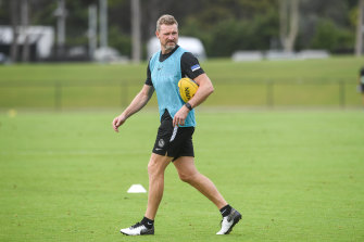 Collingwood coach Nathan Buckley oversees training on Monday.