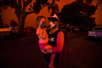 Mike and daughter Elsie wait for help getting out of fire-ravaged Mallacoota.