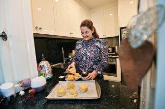 Angela Maglieri prepares a plate of scones.