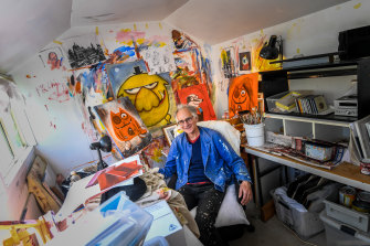 Hobbs in his fabulously cluttered studio, where he works only in pen, ink and paint.