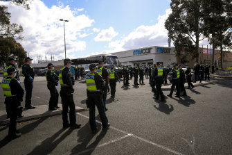 Police and riot squad search for protesters near Northcote Plaza and All Nations Park on Friday.