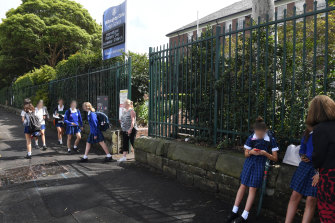 Students leaving Willoughby Girls High on Monday morning after a case of coronavirus was identified in the school.