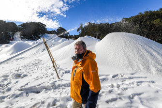 Mount Baw Baw general manager Andrew Tingate beside the mounds of manmade snow.