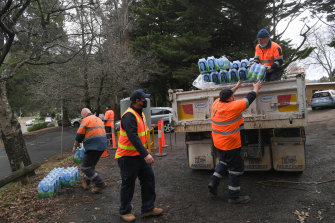 Yarra Valley Water bring in drinking water tanks and bottles for Kallista residents on Wednesday.