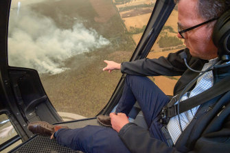 Victorian Premier Daniel Andrews flies in helicopter over the East Gippsland fires in Victoria, New year's Day.