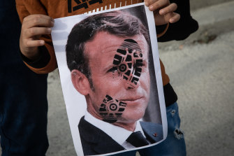 A poster of French President Emmanuel Macron marked with a shoe print at a protest in Turkey on Sunday.