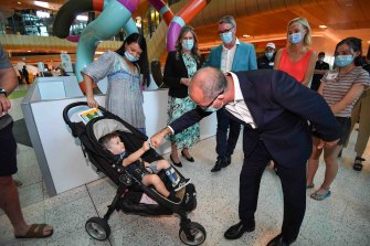 Acting Premier James Merlino greets two-year-old Malu Hunt at The Royal Children's Hospital during the Good Friday Appeal.