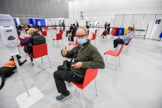 Leigh Henningham gives the thumb's up at the mass vaccination site at the Melbourne Convention and Exhibition Centre.
