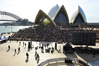 People gather on the steps of the Opera House for the memorial service of former prime minister Bob Hawke.