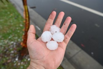 Dangerous storms tore through Sydney suburbs on Thursday afternoon, bringing with it large hail stones to the city's north-west.