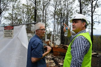 Peter Hassell (left) at the site of his home that was destroyed by fire in November with Deputy Premier John Barilaro.
