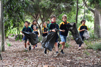 Scouts Victoria is among the organisations calling for a review of the state government's plan for a container deposit scheme. Pictured are scouts from the First Glen Iris Scout Hall.