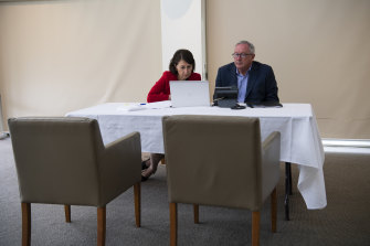 Premier Gladys Berejiklian and Minister for Health Brad Hazzard during a video hook up for Wednesday's crisis cabinet meeting.