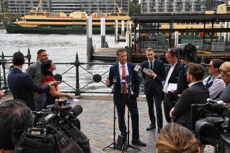 Transport Minister Andrew Constance confirms the retirement of three of the Freshwater ferries as one of them sails from Circular Quay.