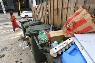 Overflowing rubbish bins in South Yarra on Tuesday. Waste levels have surged during the COVID-19 lockdown.