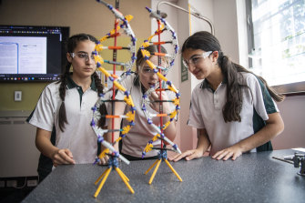 Year 8 students at St Ursula's Kingsgrove, Sienna Ferreira, Jasmine Schmidtke and Theresia Eid, during a science lesson.