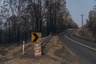 "A sign reading ""U Loot We Shoot"" on Lake Conjola Entrance Road."