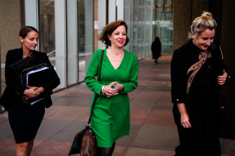Jo Dyer, centre, outside the Federal Court in May.