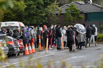 People line up for COVID-19 testing at Epping Memorial Community Hall in Melbourne's northern suburbs.