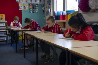 Emu Plains Public School year 3 students work at a distance during the phased return to school.