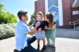 Sophie Butcher, who will start prep on Thursday at St Margaret's Primary School, with her mother Catherine Tanner and father Sam Butcher.