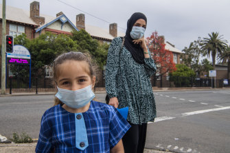Nesrine Dirani and daughter Zara on their way to Hurstville Public School for the first day of school.