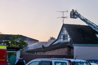A ladder truck was used to extinguish the blaze from above but Fire and Rescue NSW said the roof of the property had collapsed.