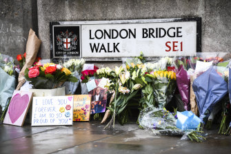 Flowers left at London Bridge in memory of Jack Merritt and Saskia Jones, who were killed in the 2019 attack.