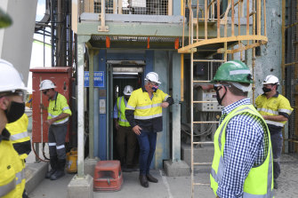 Prime Minister Scott Morrison thanks workers after emerging from a lift after being temporarily stuck inside due to a door failure during a visit to South32 Cannington Mine in McKinlay, Queensland on Wednesday.