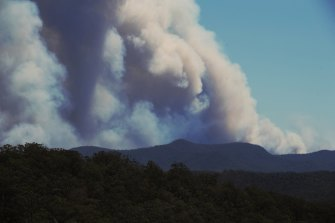 Putty RFS members watch the Gospers Mountain Fire move south east on Thursday.