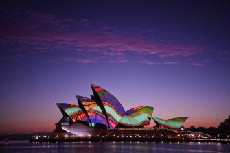 An Indigenous image is projected onto the Sydney Opera House at dawn on January 26.