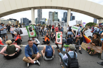 Activists from Extinction Rebellion take over the William Jolly Bridge in Brisbane in October.