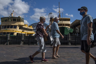 People wearing masks at Circular Quay in Sydney on Wednesday.