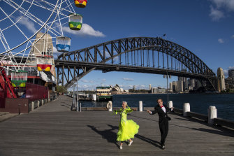 Roger Selby and Sue Johnson practising ballroom dance moves while social distancing at Milsons Point.